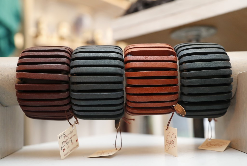 """Wooden bangles are displayed at Bhoomki, a store specializing in """"ethically-fashioned"""" and hand-crafted clothing and jewelry, Tuesday, Jan. 23, 2018,"""