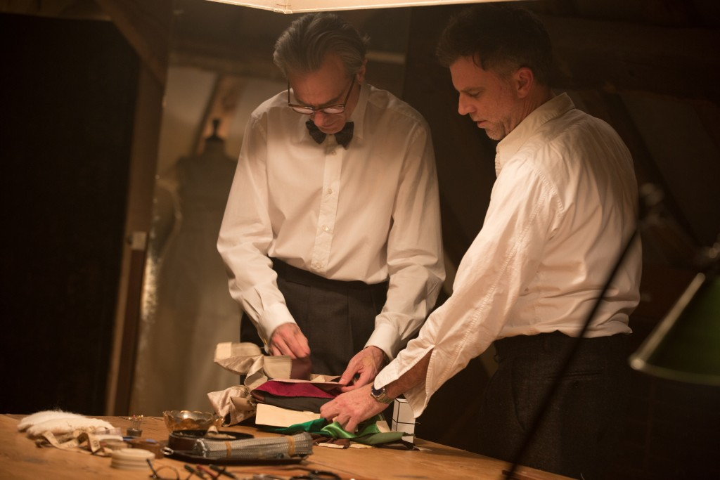 """This image released by Focus Features shows actor Daniel Day-Lewis, left, and director Paul Thomas Anderson on the set of """"Phantom Thread.""""  Anderson"""