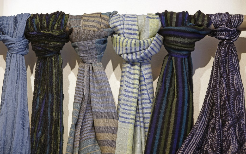 Fair trade- certified and handloom-woven wool and silk scarves made by North Indian artisans are displayed at Bhoomki, a Brooklyn store specializing i