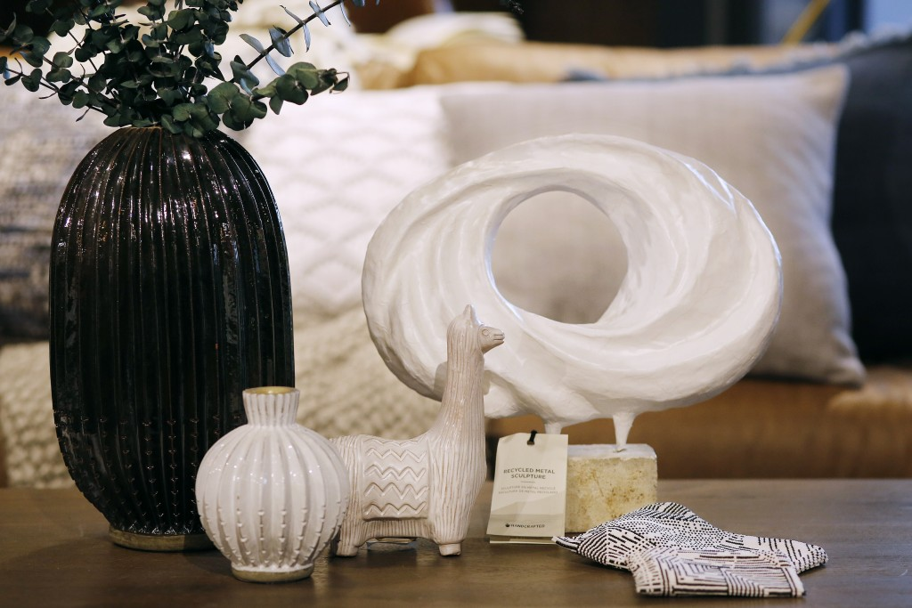 In this Monday, Jan. 22, 2018, photo, a group of artisanal items are displayed at a West Elm store in New York. From left to right are: rustic vases m
