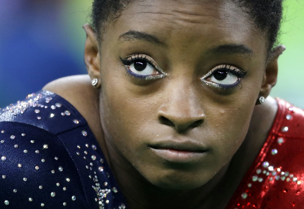 FILE - In this Aug. 7, 2016, file photo, United States' Simone Biles waits to perform her floor routine during the artistic gymnastics women's qualifi...
