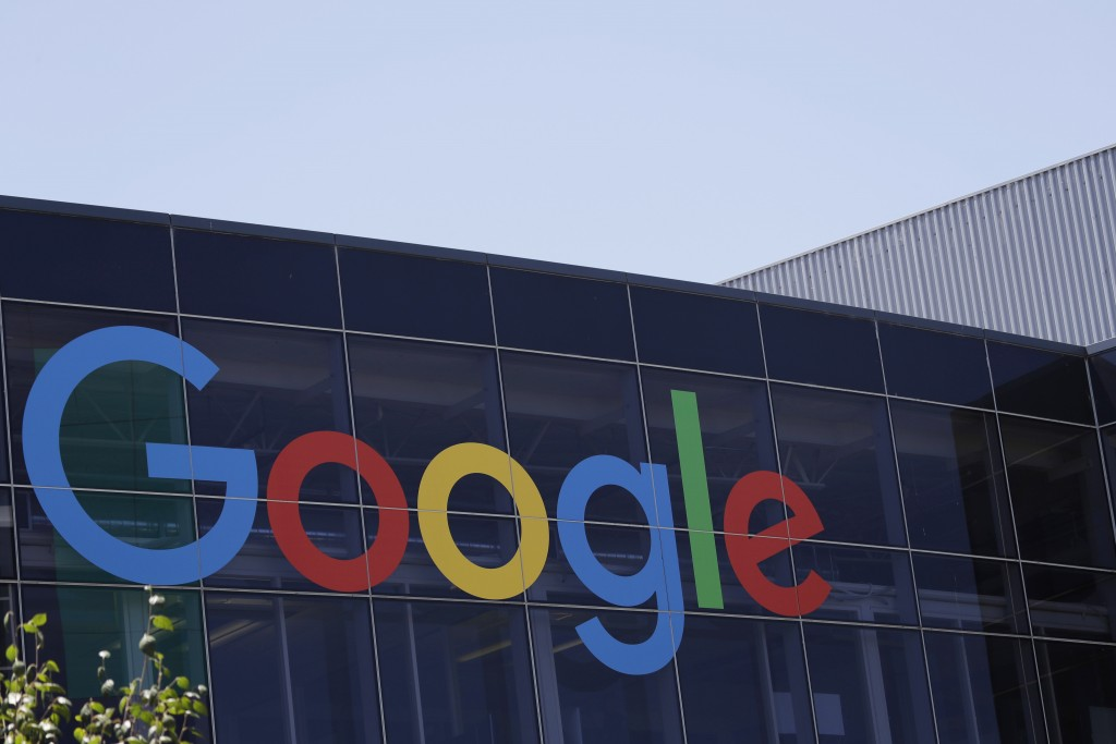 FILE - This Tuesday, July 19, 2016, file photo shows the Google logo at the company's headquarters in Mountain View, Calif. Google parent Alphabet Inc...