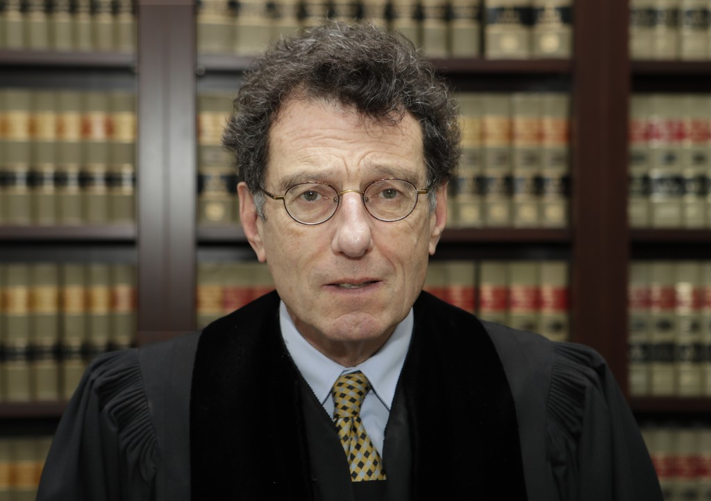 """FILE - This Jan. 11, 2018 file photo shows judge Dan Polster in his office in Cleveland. Polster has called the opioid addiction epidemic """"100 percent"""