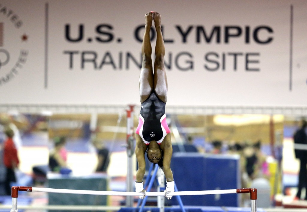 FILE - In this Sept. 12, 2015, file photo, U.S. gymnast Simone Biles trains at the Karolyi Ranch in New Waverly, Texas. Biles has met the new presiden...