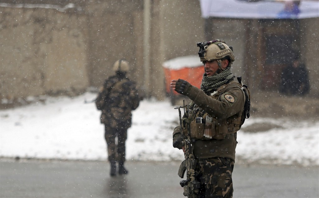 Afghan security personnel stand guard at the site of an attack at the Marshal Fahim academy in Kabul, Afghanistan Monday, Jan. 29, 2018. Islamic State...