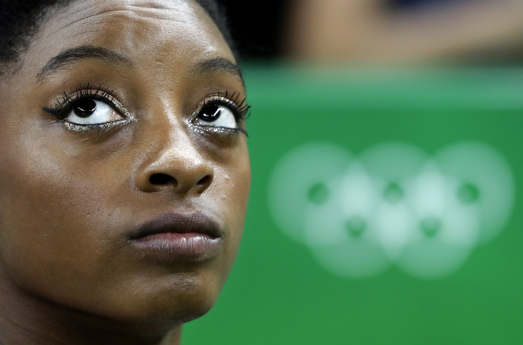 FILE - In this Aug. 11, 2016, file photo, United States' Simone Biles waits to perform on the balance beam during the artistic gymnastics women's indi...