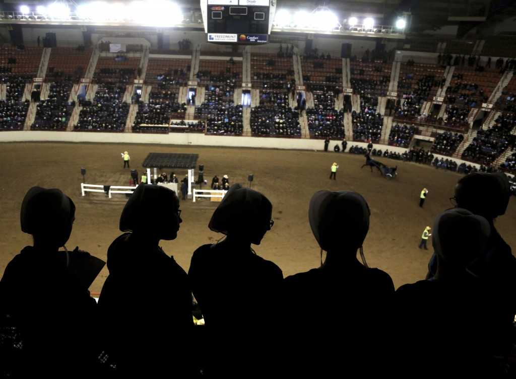 Teenage girls gather to watch a harness horse auction at the Pennsylvania Farm Show Complex Wednesday Jan.17, 2018 in Harrisburg, Pa. Amish from all o