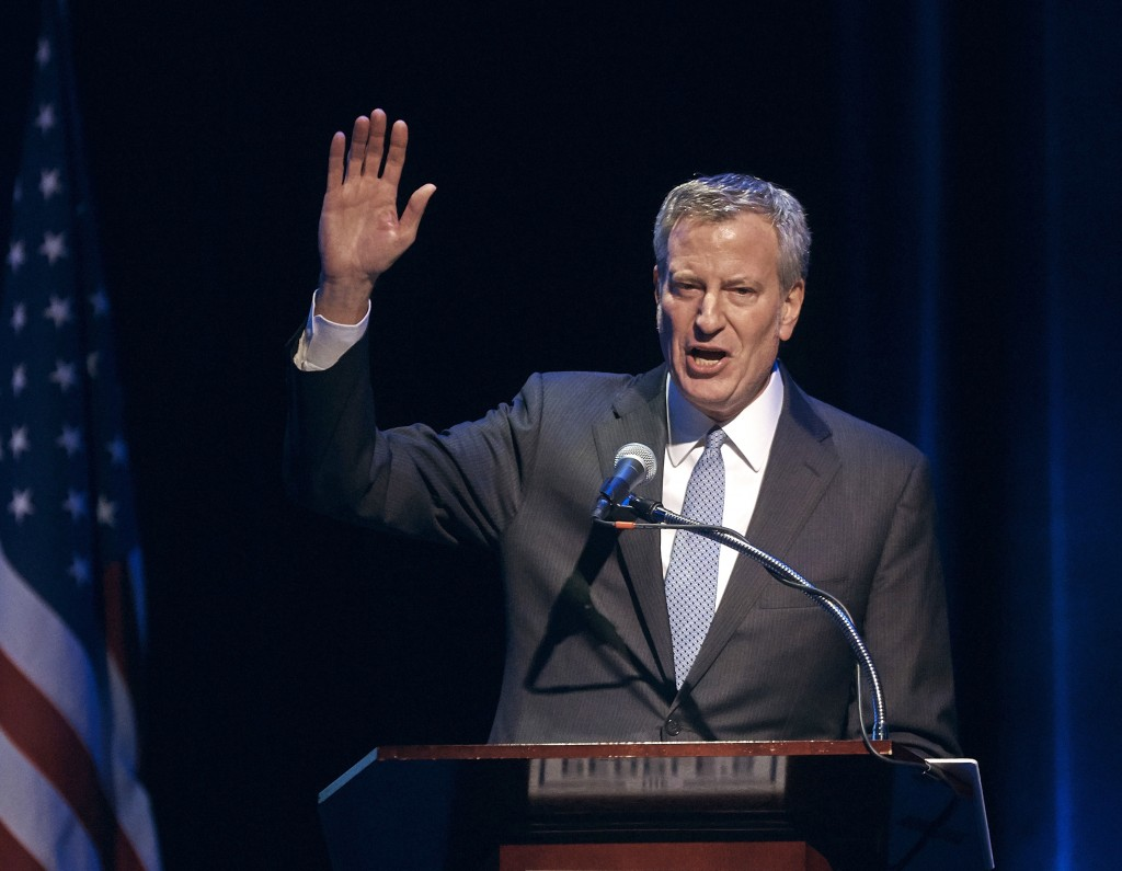 """FILE- In this Jan. 29, 2018 file photo, New York City Mayor Bill de Blasio speaks during the """"People's State of the Union"""" event at The Town Hall in N..."""