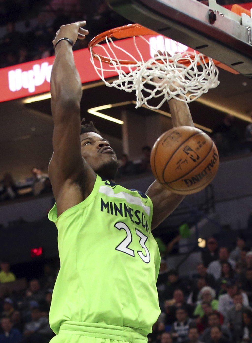 Minnesota Timberwolves' Jimmy Butler dunks against the New Orleans Pelicans in the first half of an NBA basketball game Saturday, Feb. 3, 2018, in Min...