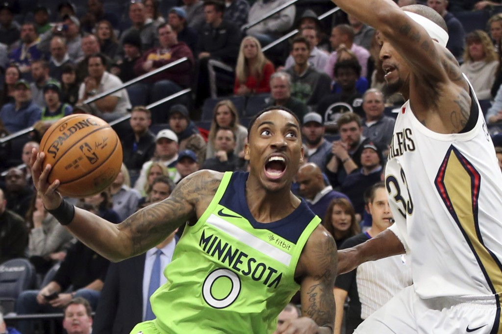 Minnesota Timberwolves' Jeff Teague, left, drives around New Orleans Pelicans' Dante Cunningham in the first half of an NBA basketball game Saturday, ...