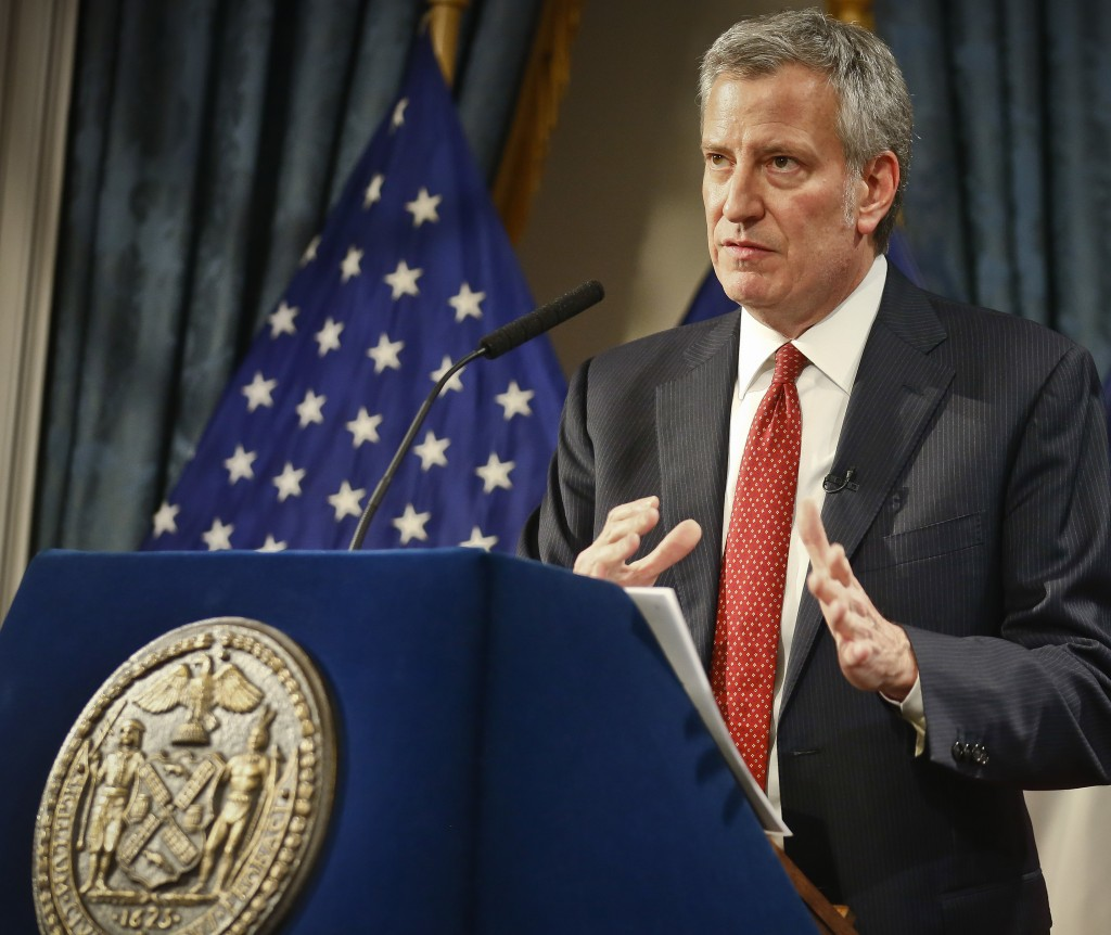 FILE- In this Feb. 1, 2018 file photo, New York City Mayor Bill de Blasio speaks as he presents his preliminary budget during a news conference at Cit...