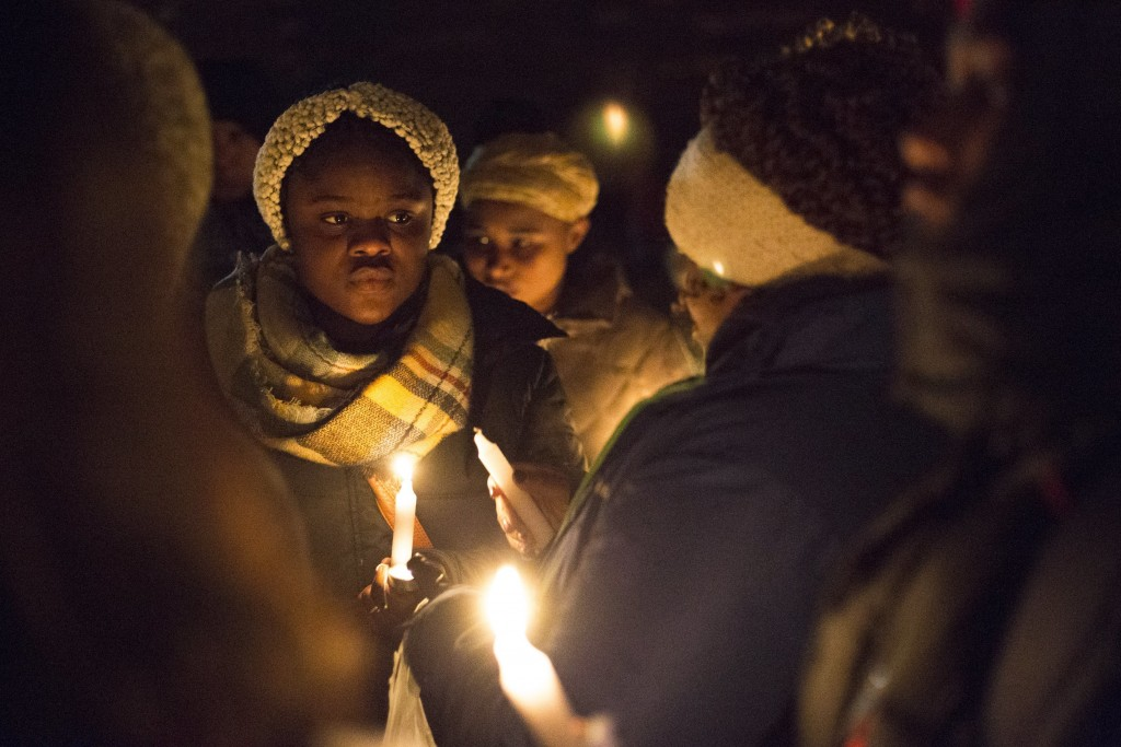 Dozens of people braved the freezing temperature to gather together and hold a vigil for Mujey Dumbuya, 16, at her bus stop across the street from the