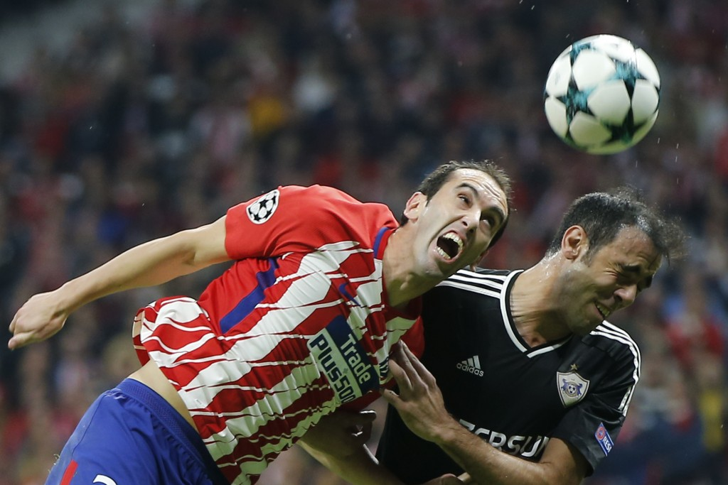 Atletico see off Valencia to close gap on Barca