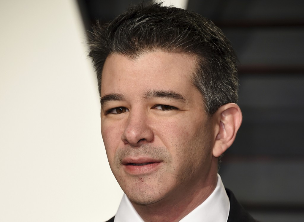 FILE - In this Feb. 26, 2017, file photo, then-Uber CEO Travis Kalanick arrives at the Vanity Fair Oscar Party in Beverly Hills, Calif. Kalanick is po...