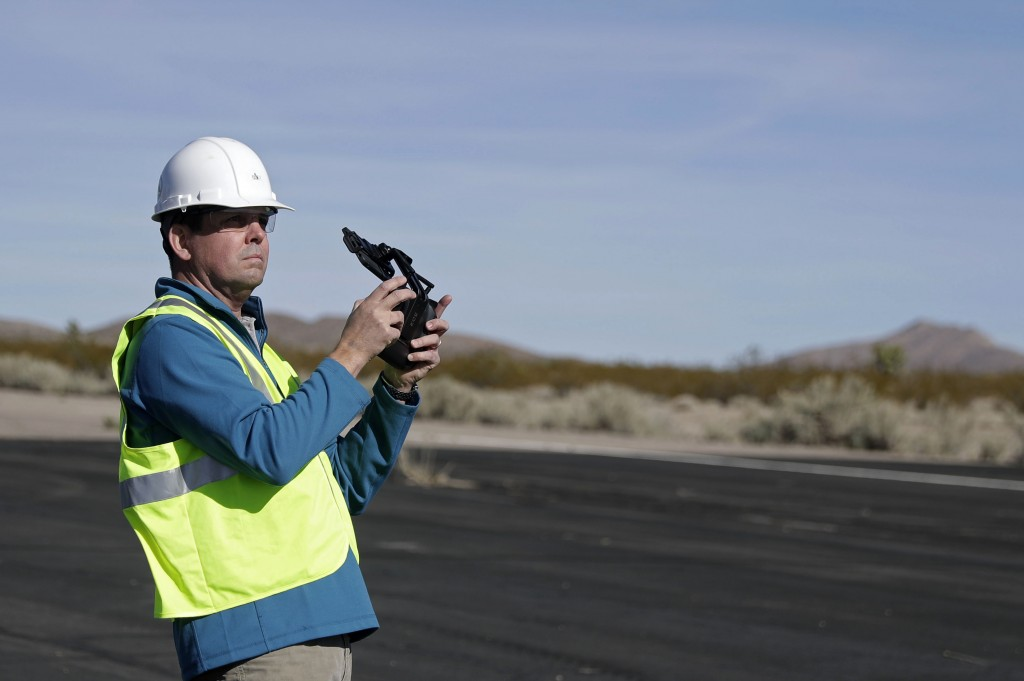 Keven Gambold, CEO of Unmanned Experts, demonstrates how to fly a drone at the Searchlight airport in Searchlight, Nev., on Wednesday, Jan. 17, 2018. ...