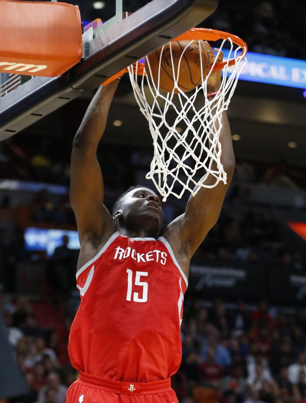 2ca60446b7b2 Houston Rockets center Clint Capela dunks the ball during the first half of  an NBA basketball