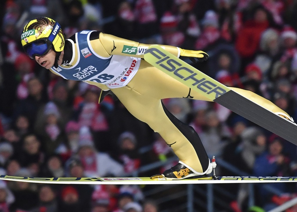 FILE - In this Jan. 28, 2018 file photo, Japan's Noriaki Kasai soars through the air during the 18th World Cup Ski Jumping competition, in Zakopane, P
