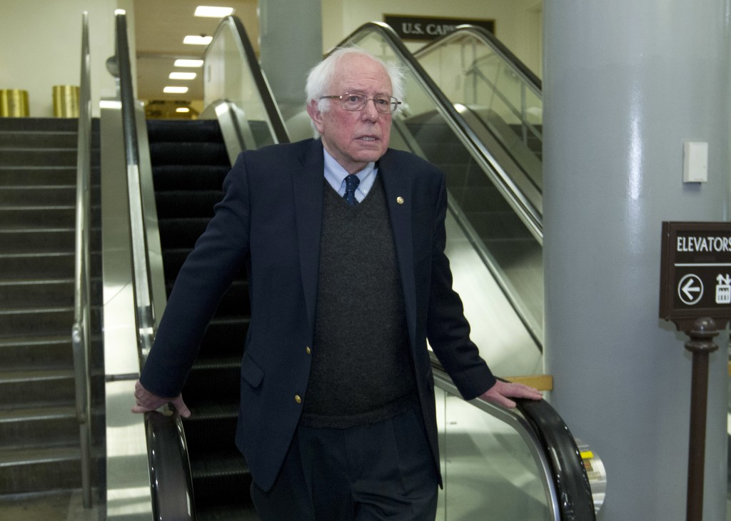 Sen. Bernie Sanders, I-Vt., walks to his office, Friday, Feb. 9, 2018, at Capitol Hill in Washington. (AP Photo/Jose Luis Magana)