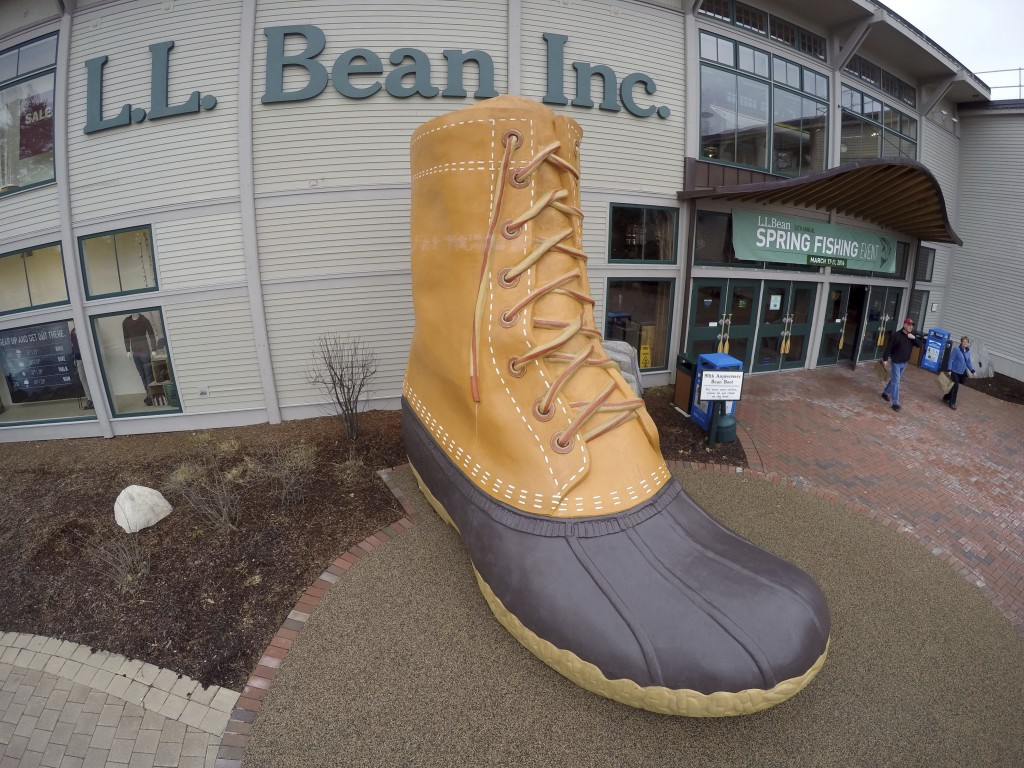 FILE - In this March 16, 2016, file photo, shoppers exit the L.L. Bean retail store in Freeport, Maine.   L.L. Bean is tightening its generous return