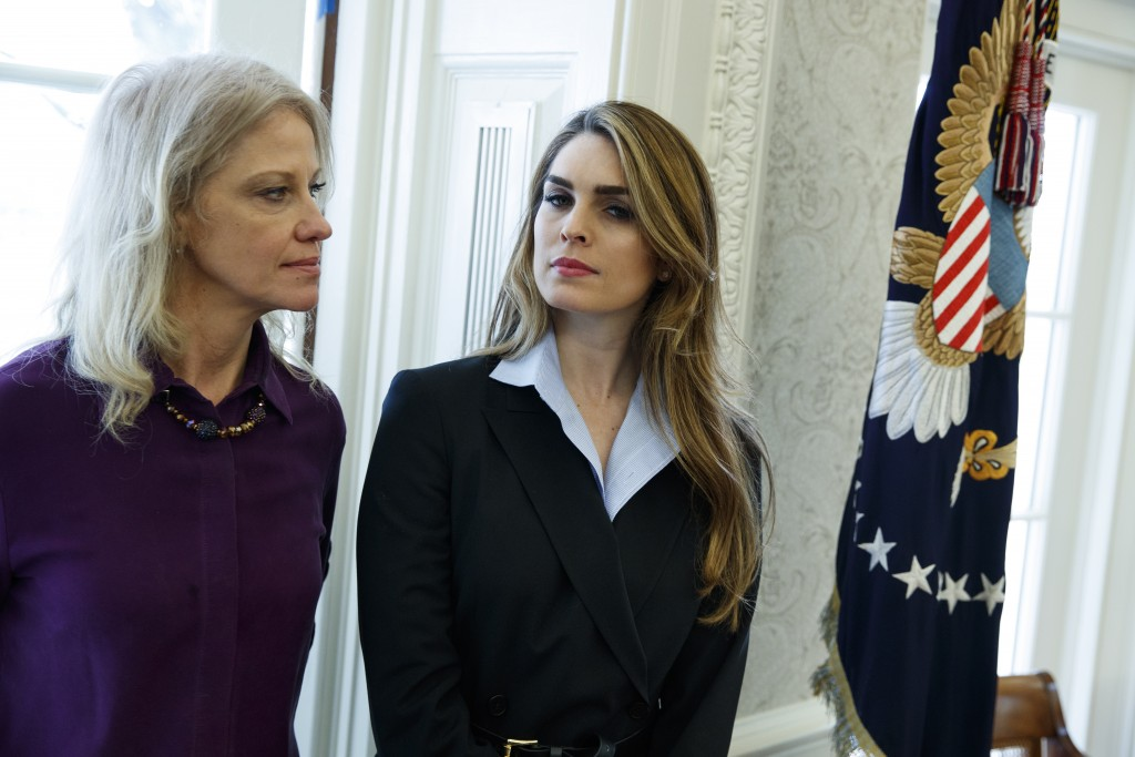 White House Communications Director Hope Hicks, right, stands with White House senior adviser Kellyanne Conway during a meeting in the Oval Office bet