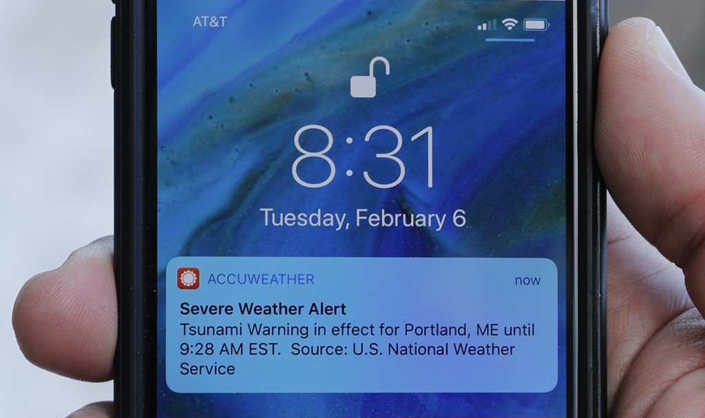 In this Thursday, Feb. 8, 2018 photo Jeremy DaRos shows the erroneous tsunami alert he received on his phone on Tuesday, Feb. 6, 2018, in Portland, Ma...