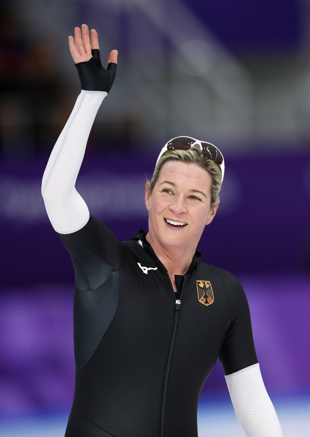 Claudia Pechstein, of Germany waves to fans after competing during the women's 3,000 meters race at the Gangneung Oval at the 2018 Winter Olympics in