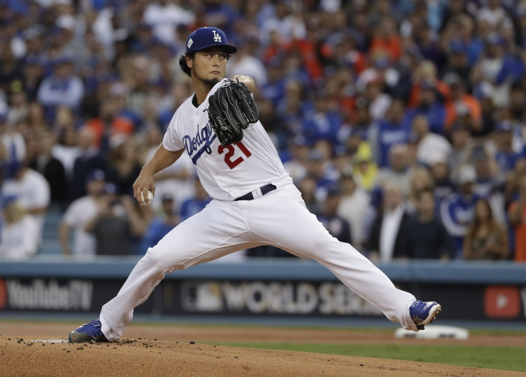 FILE - In this Nov. 1, 2017, file photo, Los Angeles Dodgers starting pitcher Yu Darvish throws during the first inning of Game 7 of baseball's World