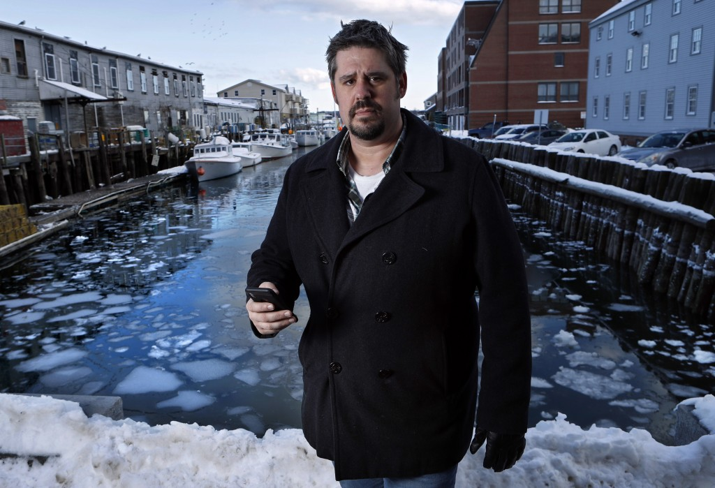"""In this Thursday, Feb. 8, 2018 photo Jeremy DaRos, who received an erroneous tsunami alert on his phone, poses on the waterfront in Portland, Maine. """"..."""
