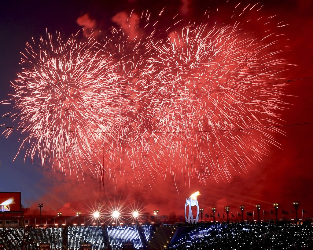 Fireworks detonate after the Olympic flame was lit during the opening ceremony of the 2018 Winter Olympics in Pyeongchang, South Korea, Friday, Feb. 9