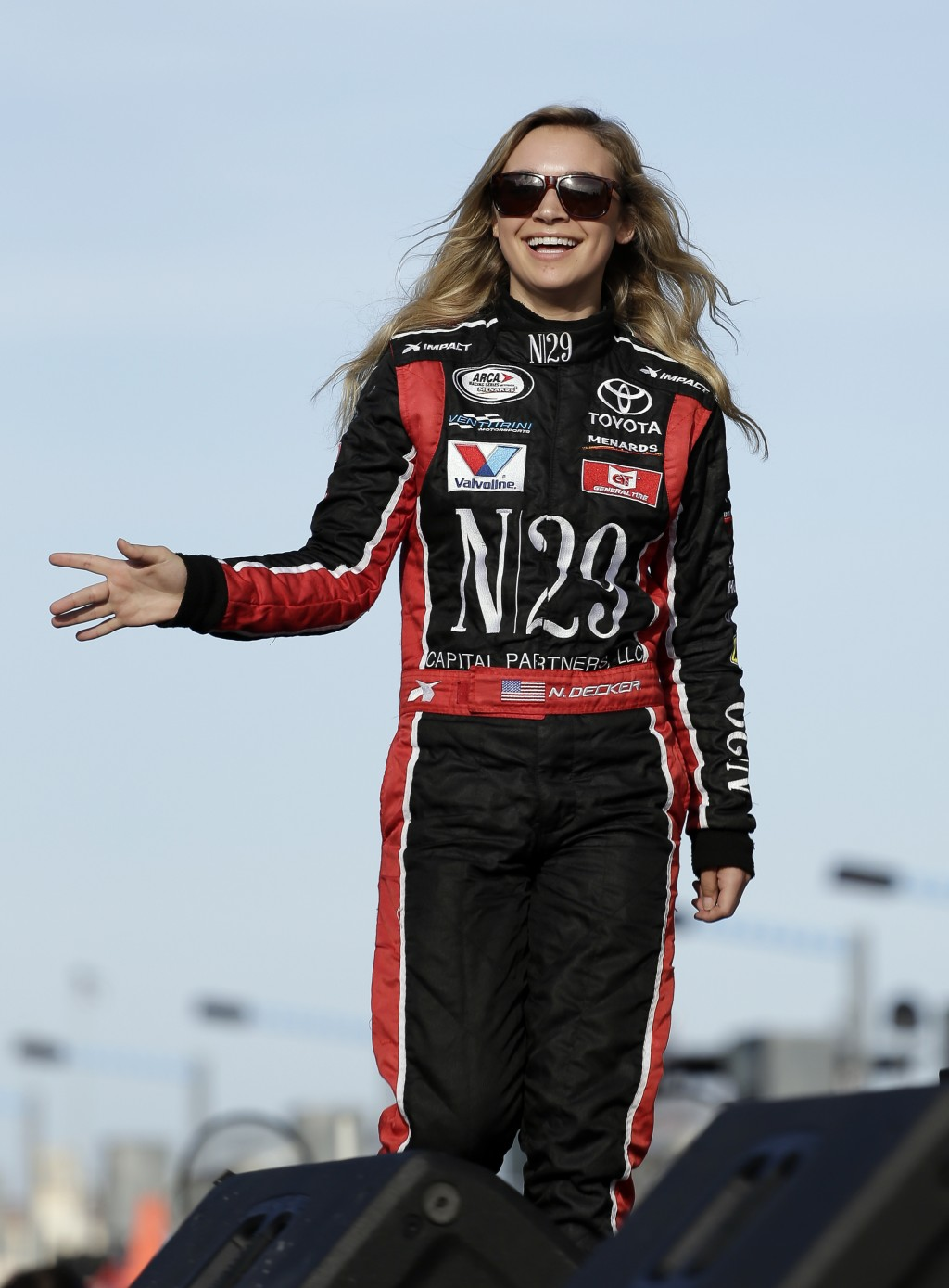Pole sitter Natalie Decker waves to fans during driver introductions before the start of the ARCA auto race at Daytona International Speedway, Saturda