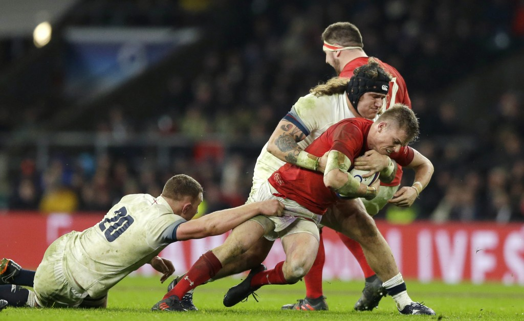 Wales' Gareth Anscombe, is brought down by England's Alec Hepburn, centre and England's Sam Underhill, left, during the Six Nations international rugb