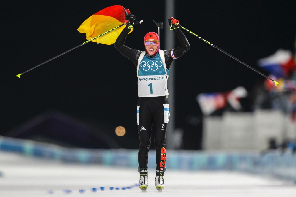 Laura Dahlmeier, of Germany, crosses the finish line to win the gold medal in the women's 10-kilometer biathlon pursuit at the 2018 Winter Olympics in