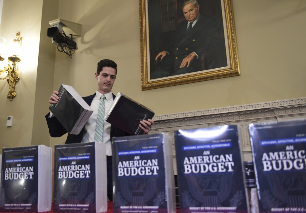James Knable helps to unpack copies of the President's FY19 Budget after it arrived at the House Budget Committee office on Capitol Hill in Washington