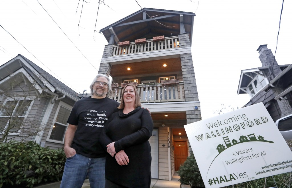 In this Thursday, Jan. 11, 2018, photo, Bryan Kirschner, left, and his wife, Holly Ferguson, supporters of a proposed development plan, stand in front...