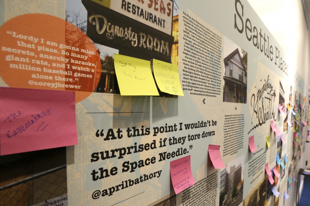 In this Dec. 15, 2017, photo, a display in the Vanishing Seattle pop-up store in Pike Place Market in Seattle encourages visitors to post notes about ...