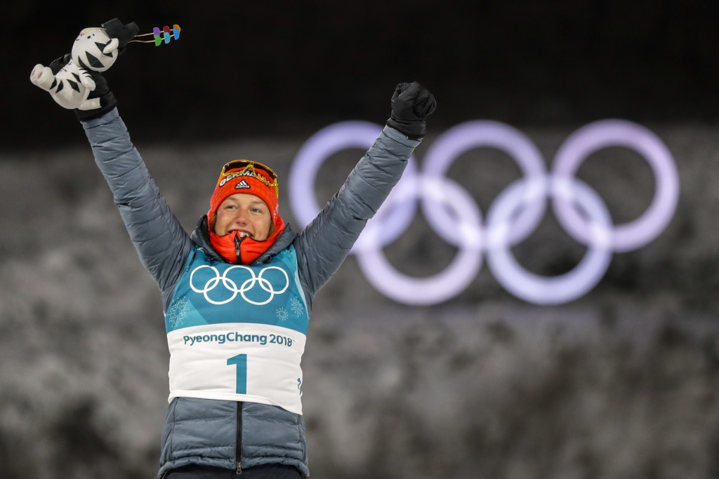 Gold Medalist Laura Dahlmeier, of Germany, celebrates during the venue ceremony at the women's 10-kilometer biathlon pursuit at the 2018 Winter Olympi