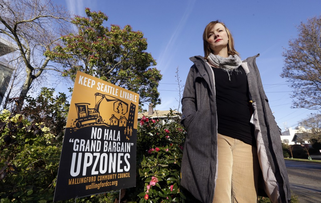 In this Dec. 13, 2017, photo, Susanna Lin, a member of a neighborhood group opposed to a proposed development plan, stands in her neighborhood in Seat...