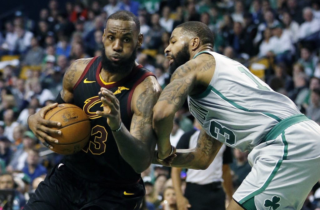 Cleveland Cavaliers' LeBron James (23) drives past Boston Celtics' Marcus Morris (13) during the third quarter of an NBA basketball game in Boston, Su