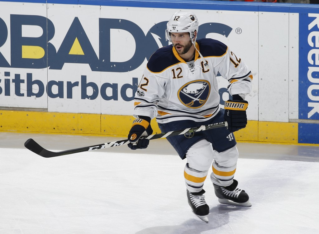FILE - In this April 8, 2017, file photo, Buffalo Sabres right wing Brian Gionta (12) skates prior to an NHL hockey game against the Florida Panthers,