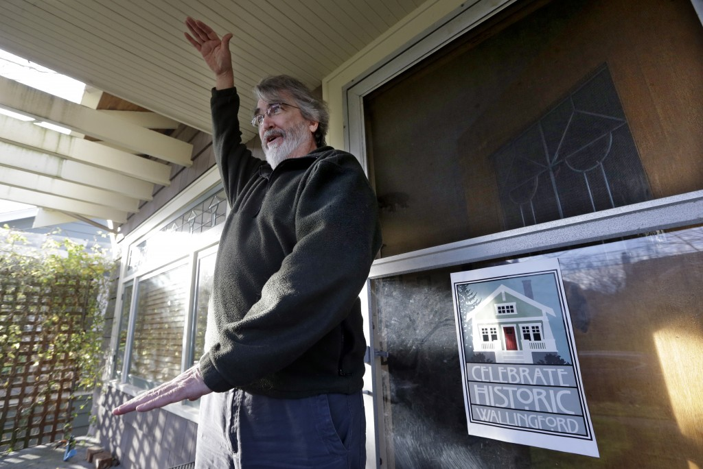 In this Dec. 13, 2017, photo, Greg Flood stands on the porch of his two-story home and talks about a proposal to allow houses to be built three-to-fiv...
