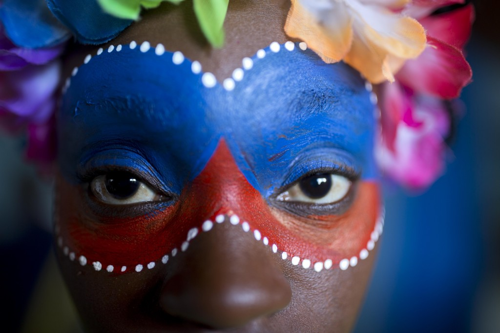 A carnival reveler poses for a picture before the start of a carnival parade in Port-au-Prince, Haiti, Monday, Feb. 12, 2018. ( AP Photo/Dieu Nalio Ch