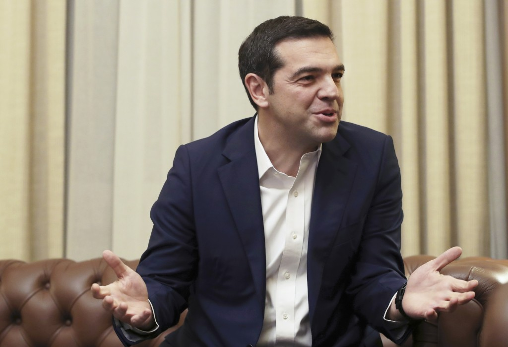 FILE - In this file photo dated Friday, Jan. 26, 2018, Greek Prime minister Alexis Tsipras during discussions in Athens.  In a formal request to parli