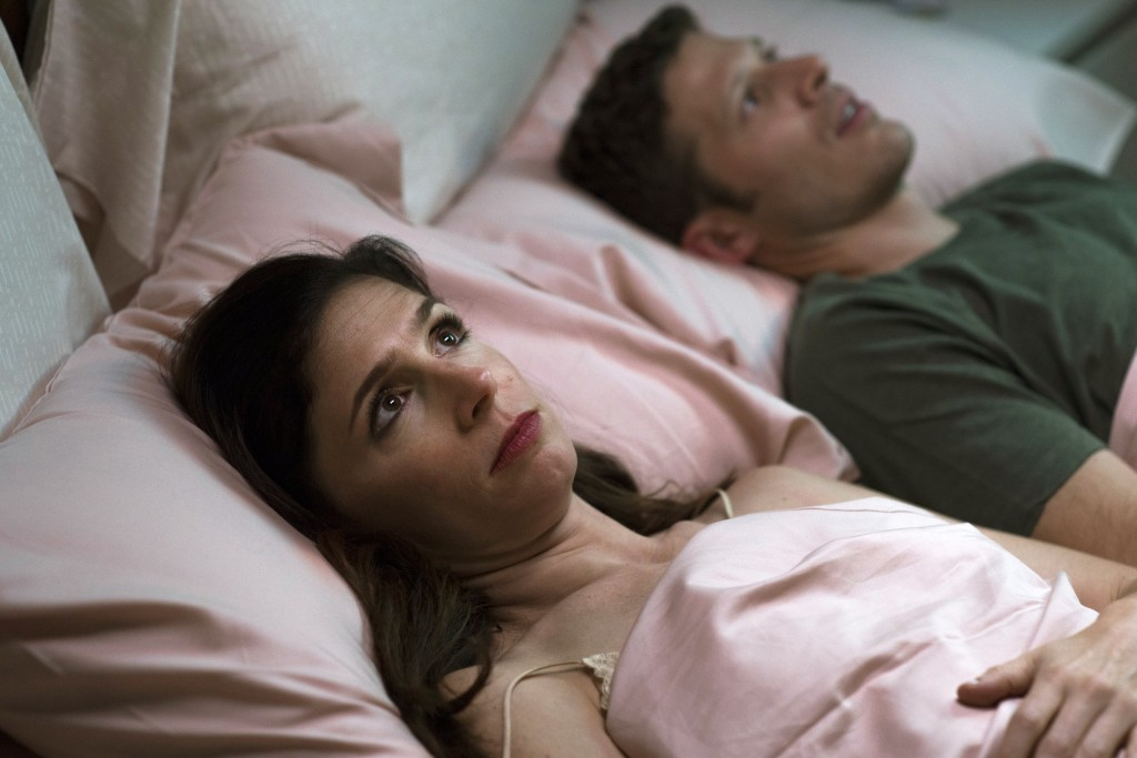 "This image released by Sundance Now shows Shoshannah Stern, left, and Zach Gilford in a scene from ""This Close,"" a series premiering Feb. 14 on Sundan"