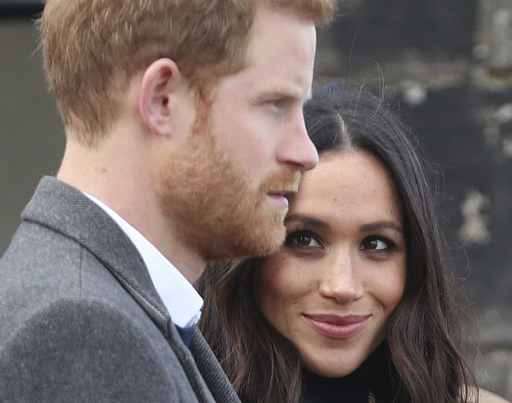 Britain's Prince Harry and his fiancee  Meghan Markle  during their visit at Edinburgh Castle, during their visit to Edinburgh Tuesday Feb. 13, 2018.(