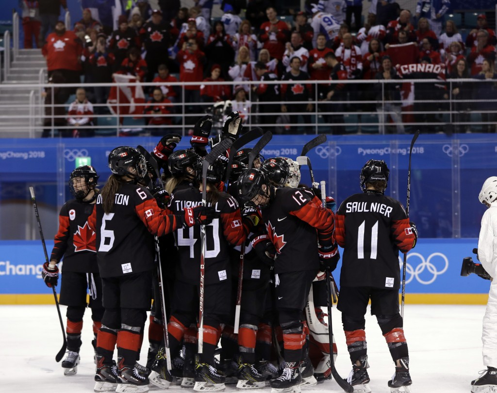 Players from Canada celebrate after the preliminary round of the women's hockey game against Finland at the 2018 Winter Olympics in Gangneung, South K