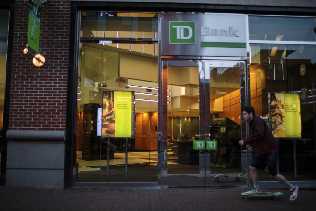 ADVANCE FOR USE THURSDAY, FEB. 15, 2018, AT 12:01 A.M. AND THEREAFTER - This Nov. 12, 2017, photo provided by Reveal shows a TD Bank storefront in Phi