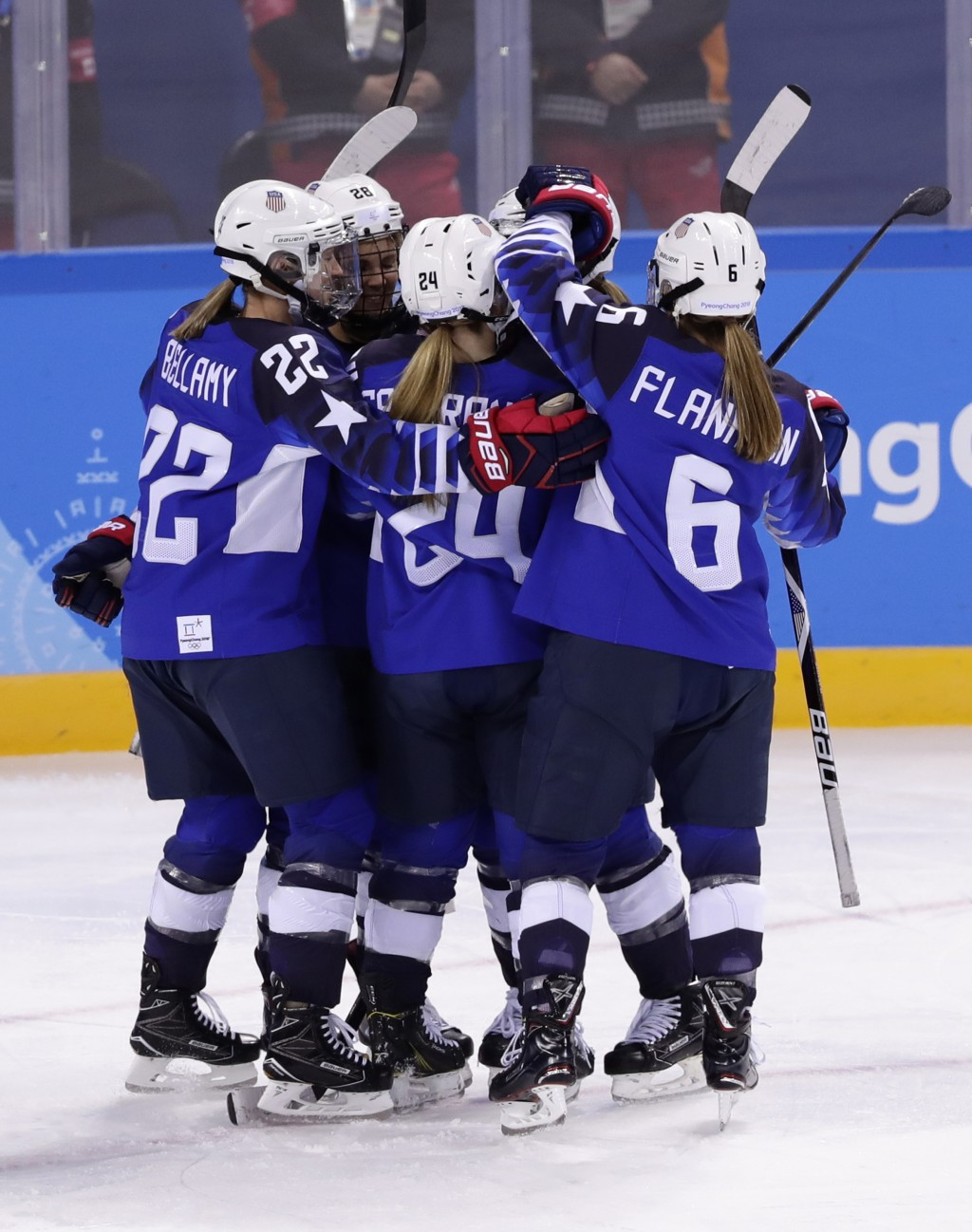 Hannah Brandt, of the United States, celebrates with her teammates after scoring a goal against the team from Russia during the third period of the pr