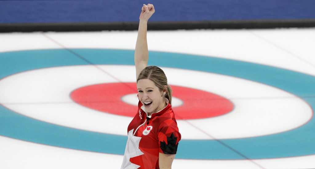 Canada's Kaitlyn Lawes celebrate after winning their mixed doubles curling match against Switzerland at the 2018 Winter Olympics in Gangneung, South K