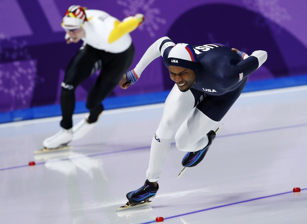 Shani Davis of the U.S., right, and Bart Swings of Belgium compete during the men's 1,500 meters speedskating race at the Gangneung Oval at the 2018 W