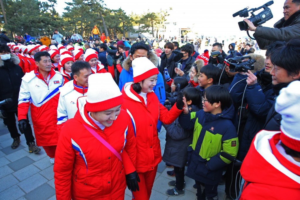 A group of North Korean cheerleaders for the Pyeongchang Winter Olympics greets South Koreans as they visit Gyeongpo Beach in Gangneung, South Korea,